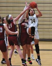 EXCELSIOR SPRINGS junior Lillian Mawby goes up for two of her six points in an MRVC West Division home win over Warrensburg. TIM HARLAN | Submitted Photo
