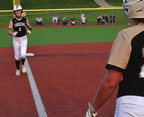 EXCELSIOR SPRINGS junior Mallory Millsap flashes a big smile as she heads for home after driving a game-tying, three-run home run over the right-center field fence Sept. 17 against visiting Oak Grove. DUSTIN DANNER | Staff