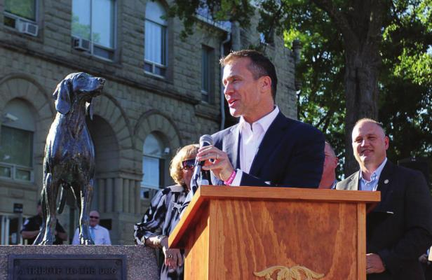 "J.C. VENTIMIGLIA | Staff THEN-GOV. Eric Greitens gives Sen. George Graham Vest's ""Eulogy to a Dog,"" written in honor of Old Drum, during a bill-signing ceremony in June 2017 on the Warrensburg square in front of the dog's statue. Behind Greitens stands Sen. Denny Hoskins, whose bill made Old Drum the official state historical dog."