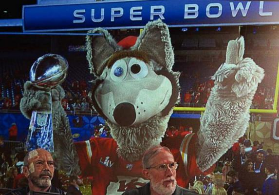 A PROJECTION during the annual Mayor's Prayer Breakfast shows KC Wolf holding the Super Bowl trophy won in February by the Kansas City Chiefs. J.C. VENTIMIGLIA | Staff