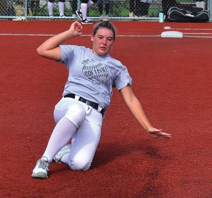 JUNIOR AVORY MOORE practices sliding into second base. DUSTIN DANNER | Staff