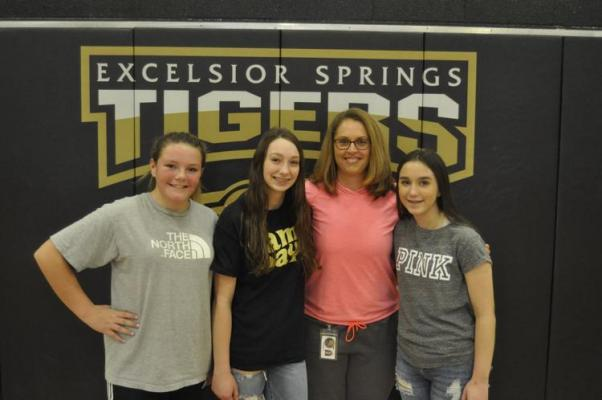 Terri Irons poses with some of her students. She will retire from Excelsior Springs High School this year, to begin what she described as a new adventure. Pictured with Irons, Destiny Dominis, Kara Lindley, and Ryley McDonald.