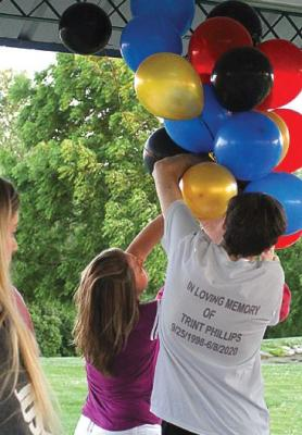IN MEMORY of Trint Phillips, balloons are arranged around 8:30 p.m. on June 11 undera pavilion roof at Century Park in Excelsior Springs for a launch that takes place at dusk, about 45 minutes later. J.C. VENTIMIGLIA | Staff