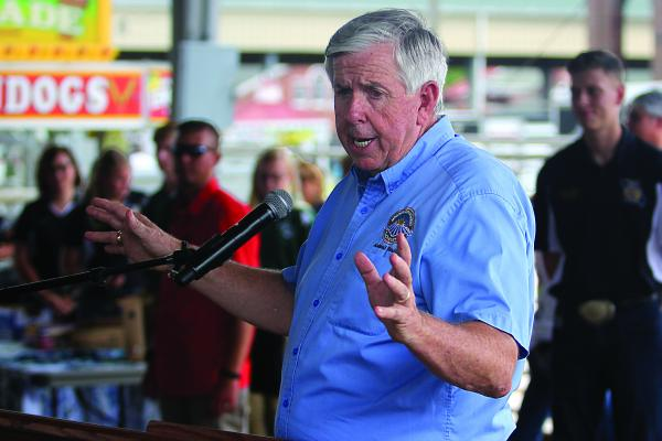 GOV. MIKE PARSON appears without a mask in mid-August at the Missouri State Fair where he talks about social responsibility being a better answer than wearing a mask to prevent the spread of COVID-19.