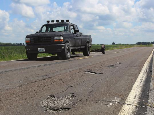 THIS DAMAGE is visible on Route J in southern Ray County. The surface, like surfaces on roads across the Northland, suffers from numerous cracks and potholes, with some of the wear being due to blowups, Missouri Department of Transportation information states. J.C. VENTIMIGLIA | Staff