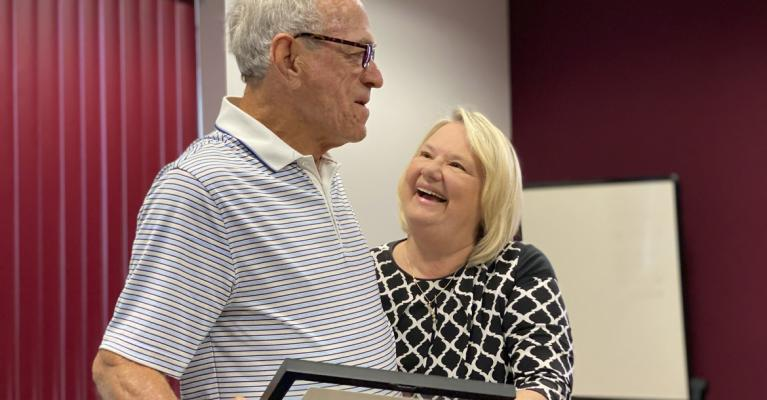Mayor Sharon Powell offers well wishes to Ambrose Buckman as he steps down from City Council Friday