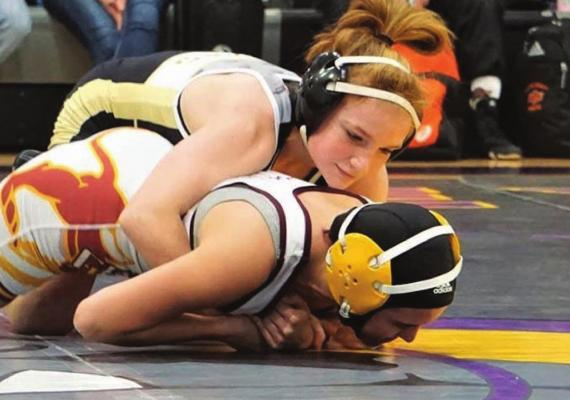 EXCELSIOR SPRINGS freshman grappler Lily Brower gains control over her opponent on her way to claiming the District 4 championship. TIM HARLAN | Special to The Standard