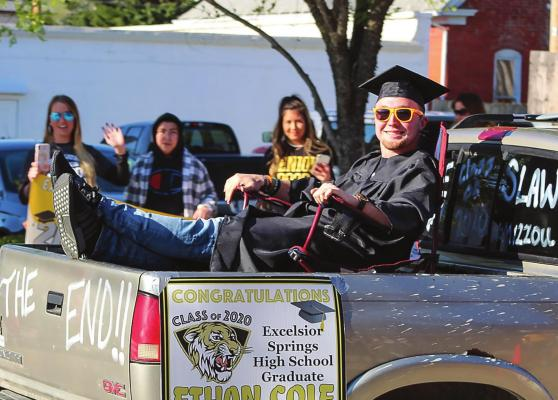 Alt Text for ImageDURING THE CLASS of 2020 Excelsior Springs High School Parade around the city May 8, Ethan Cole rocks the world from the back of a pickup truck.