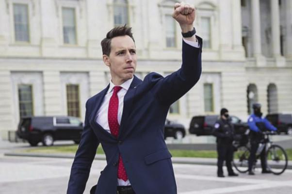 U.S. SEN. Josh Hawley raises his fist in support of the crowd that gathers in protest of the presidential election outcome, which Hawley questions. FRANCIS CHUNG | E&E News/Politico