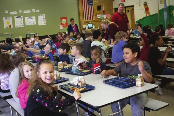 WRIGHT ELEMENTARY SCHOOL receives a grant so all students eat lunch free. The Flavor Bar's most popular items are hot sauce and banana peppers. AMY MAYER | Harvest Public Media