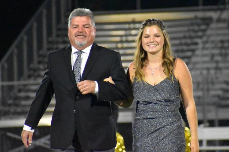 Senior princess candidate Elizabeth Casey is escorted by her father, John Casey. (Photo by Christi Rice)