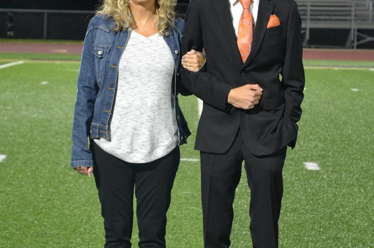 Senior king candidate Drake Clevenger is escorted by his mother Staci Clevenger. (Photo by Jae Juarez)