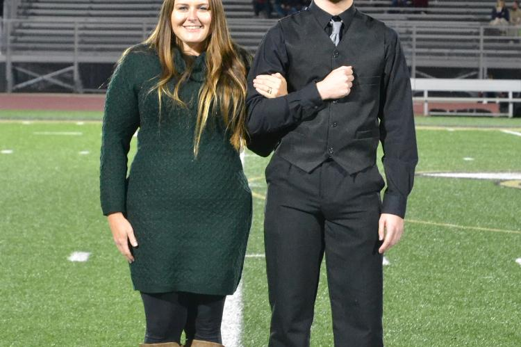 Senior king candidate Caleb Hatfield is escorted by his mother Becca Hatfield. (Photo by Jae Juarez)