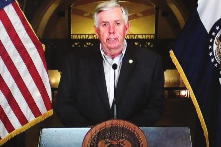 GOV. MIKE PARSON gives a coronavirus update at the Capitol in Jefferson City on March 27.