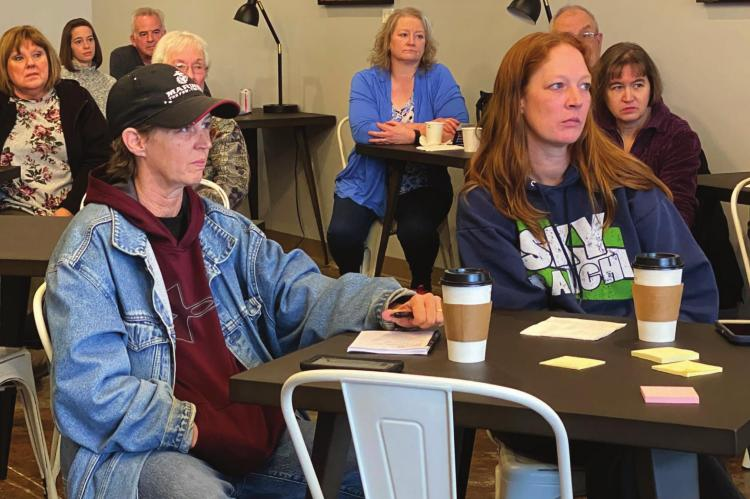 DURING THE LISTENING POST at Mug Coffeehouse on Sunday, residents Christy Dimes, left, and sister Jennifer Allen listen to the discussion about potential future uses for the long-abandoned Wyman School. BRIAN RICE | Staff