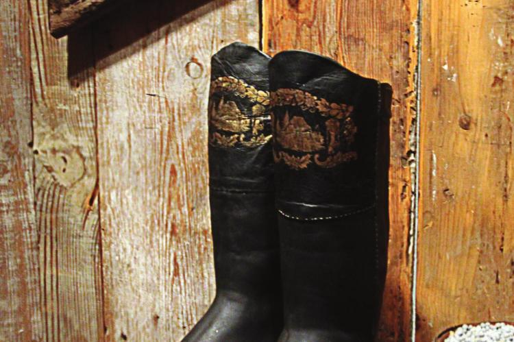 THESE BOOTS have gold gilding with frontier images. They also have enough room at the top to slip in a small pistol.