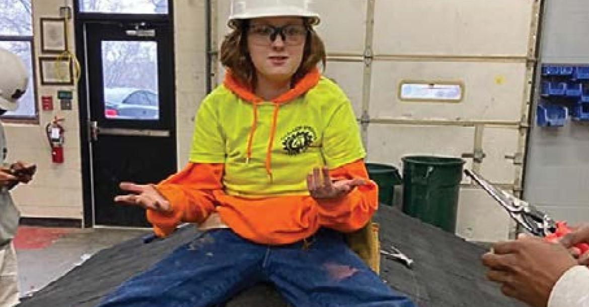 TOGETHER with certifications and a job tip from Excelsior Springs Job Corps, Lauren Randolph, 19, is working on the new terminal roof at KCI. While at Job Corps and at work on this roof model, Randolph says she felt inspired to become a roofer.