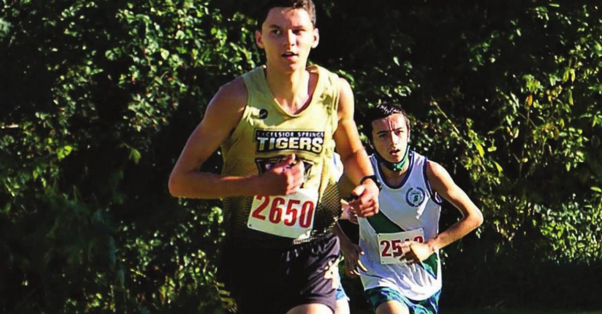 JUNIOR TYLER RUMORE paces the Tigers Oct. 6 at the Excelsior Springs Cross Country Invitational. PROVIDED COURTESY OF TIM HARLAN
