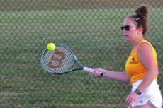 SADIE MOORE hits a forehand shot during her Oct. 1 singles win. DUSTIN DANNER | Staff