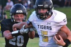 DESPITE INTENSE pursuit by Savannah defensive back Heisman Lafave, Tigers running back Lukas Shelton runs hard down the sideline during Excelsior Springs' 33-21 Aug. 28 season-opening road win. DUSTIN DANNER | Staff