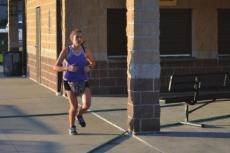 JACEY BREWER gets in a run on the Excelsior Springs High School campus. DUSTIN DANNER | Staff