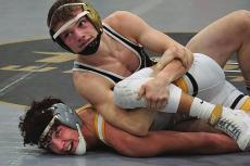 JUNIOR LANDEN DAVIS gains control on his way to the 126-pound title Feb. 27 at the Class Sectional 4 Tournament at Excelsior Springs High School. TIM HARLAN | Submitted Photo
