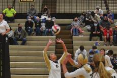 EXCELSIOR SPRINGS senior Natalie Frese sets up junior Rylie Stottlemyre in volleyball action DUSTIN DANNER | Staff